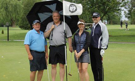 Annual golf tournament was wet, but fun