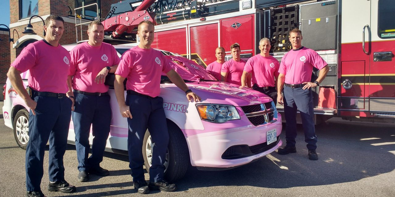 Firefighters sport pink T-shirts in October