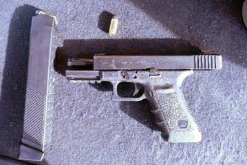 Police seize guns, cocaine in bail violation investigation